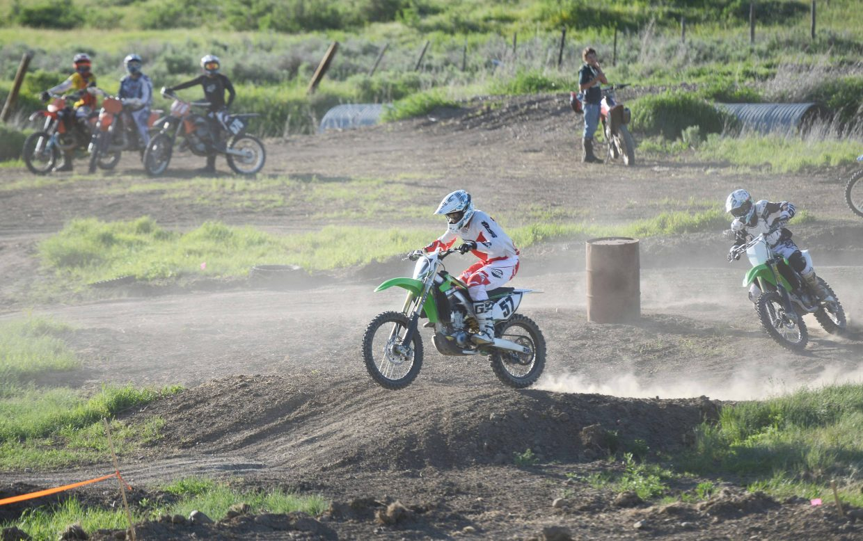 Thedo Remmelink leads the way in front of a pack of riders last week at the Stokes Gulch Motocross Track in Hayden.