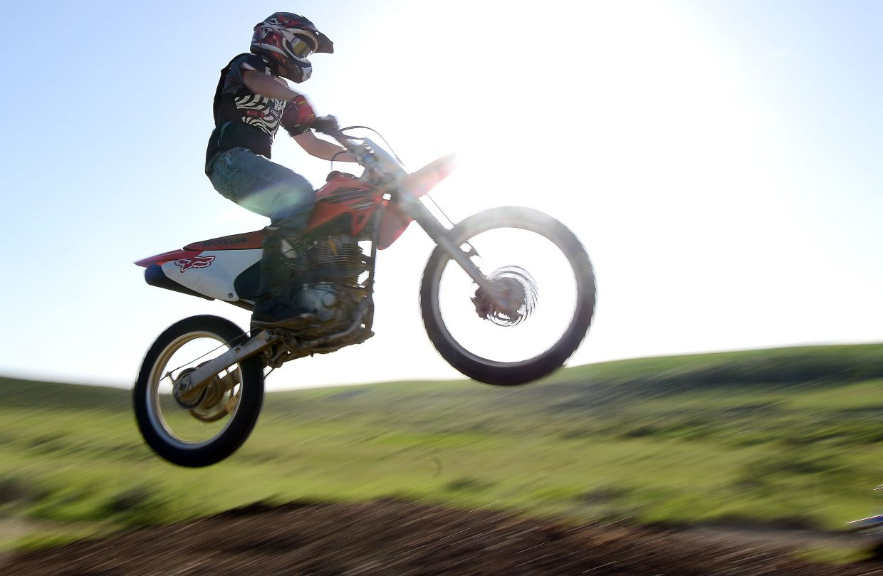 Richard Hallenbeck catches air last week at the Stokes Gulch Motocross Track in Hayden.