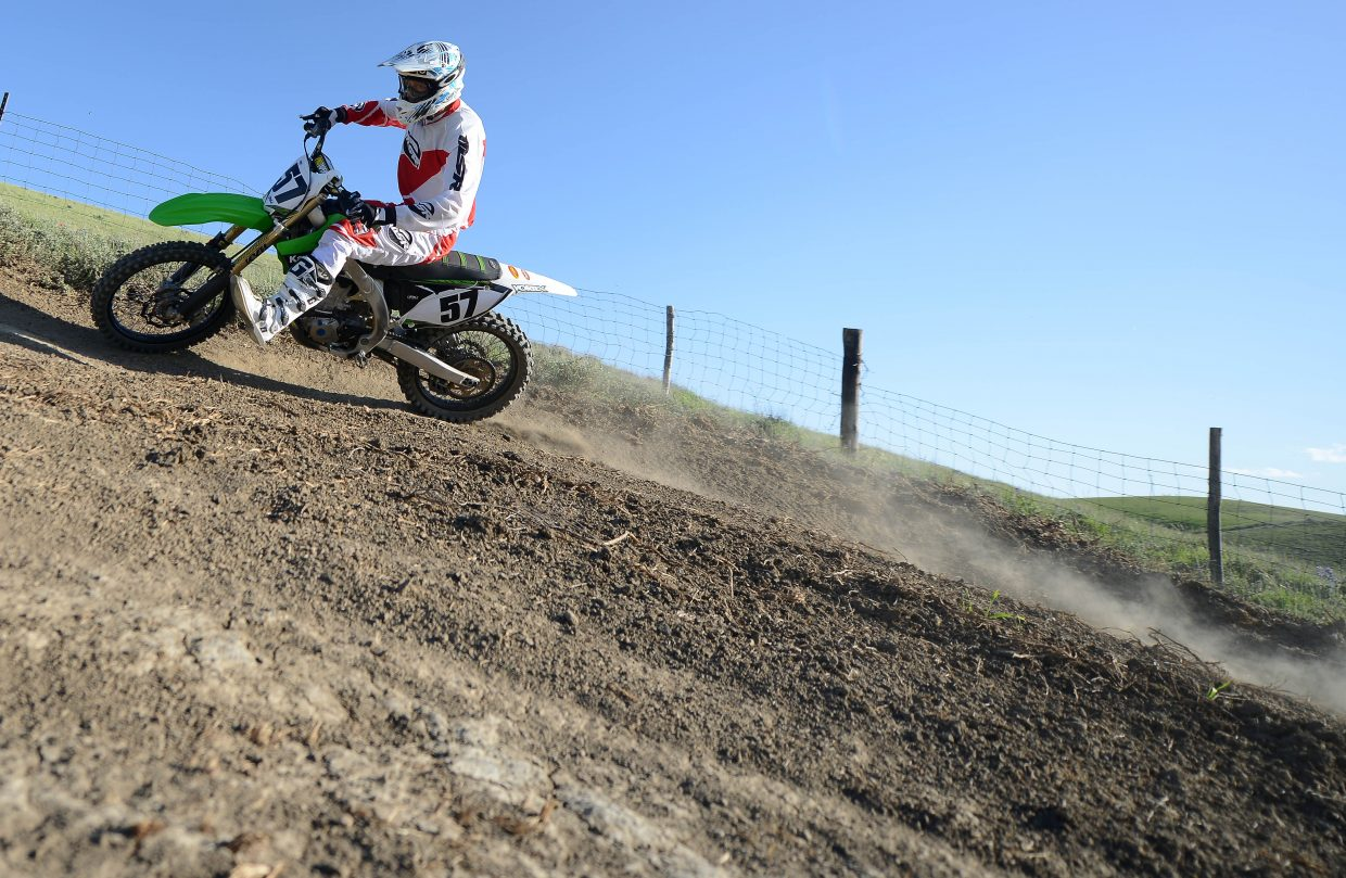 Thedo Remmelink swings around a corner at the Stokes Gulch Motocross Track in Hayden.
