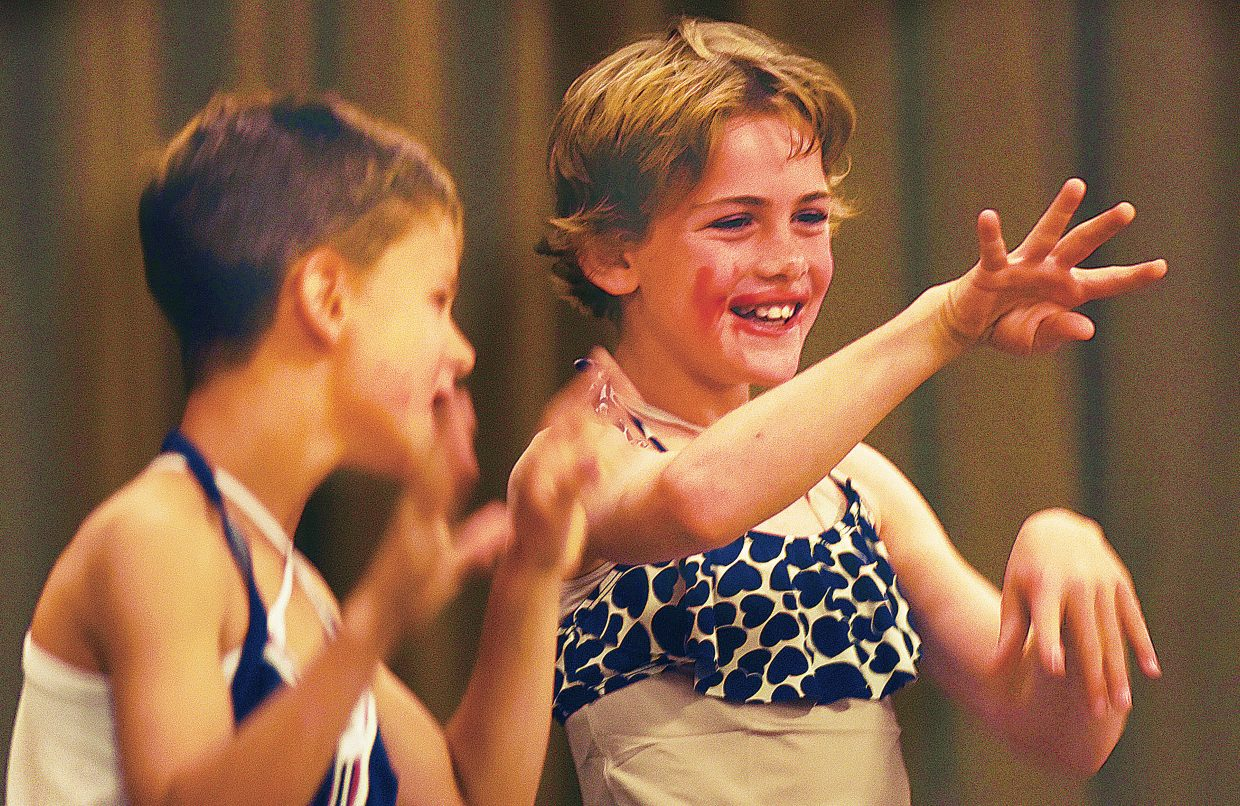 Charlie Reisman, left, and Braden Adams dance and lip sync for fellow students wearing dresses and makeup at Strawberry Park Elementary School during Wednesday's talent show. The event is one of several this week as students and staff prepare for the summer break.