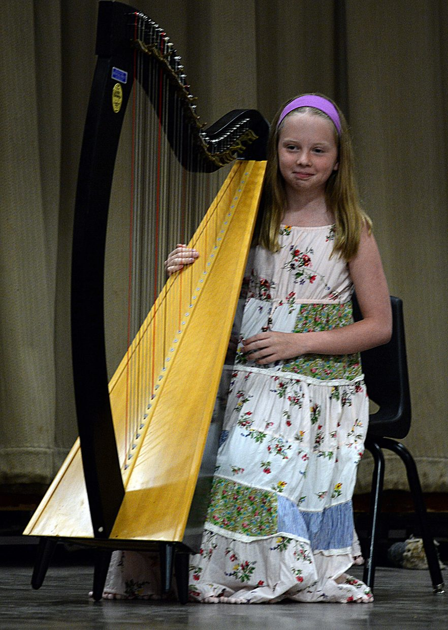 Kathryn Knapp takes the stage with her harp before performing for fellow students at Strawberry Park Elementary School during Wednesday's talent show. The event is one of several this week as students and staff prepare for the summer break.