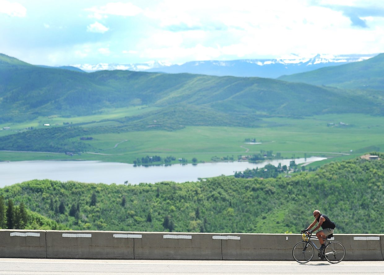 Jim Gregoire pedals along U.S. Highway 40 and up Rabbit Ears Pass on Wednesday. Gregoire, 70, said riding a bike to the pass's summit has been a summer ritual for him for nearly 50 years, since 1968.