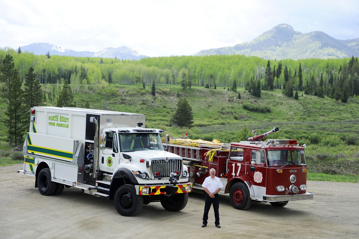 North Routt Fire Protection Chief Mike Swinsick stands in August 2017 next to a new truck that will replace their 1972 engine.