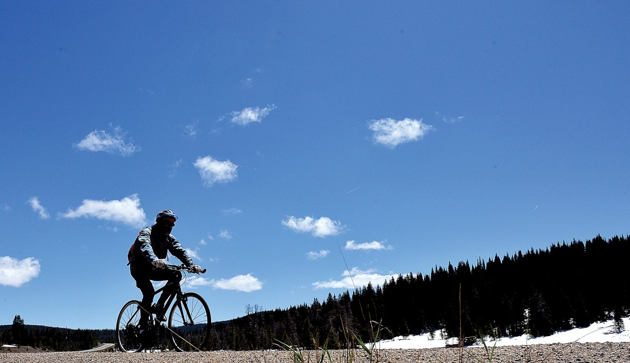 A cyclist climbs up Rabbit Ears Pass on Monday as part of the annual Ride the Rockies bike tour. More than 2,000 cyclists from across the country are taking part in the 417-mile tour that travels through the Colorado Rockies. The tour arrived in Steamboat Springs on Monday, and the riders will depart Wednesday for State Bridge. Today, the riders will complete a 54-mile-loop ride on Twentymile Road.