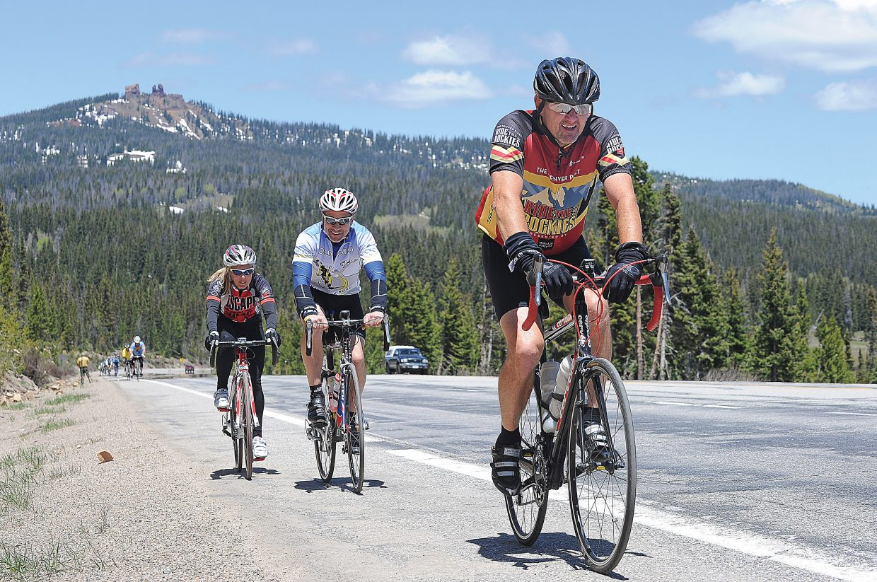 Cyclist Lonny Lee leads a pack of riders up Rabbit Ears Pass on Monday afternoon during the second day of the Ride the Rockies bike tour, which took cyclist from Winter Park along U.S. Highway 40 to Steamboat Springs. More than 2,000 cyclists are taking part in the 417-mile tour that travels through the Colorado Rockies. The tour arrived In Steamboat Springs on Monday, and the riders will depart Wednesday for State Bridge. On Tuesday, the riders will complete a 54-mile-loop ride on Twentymile Road.