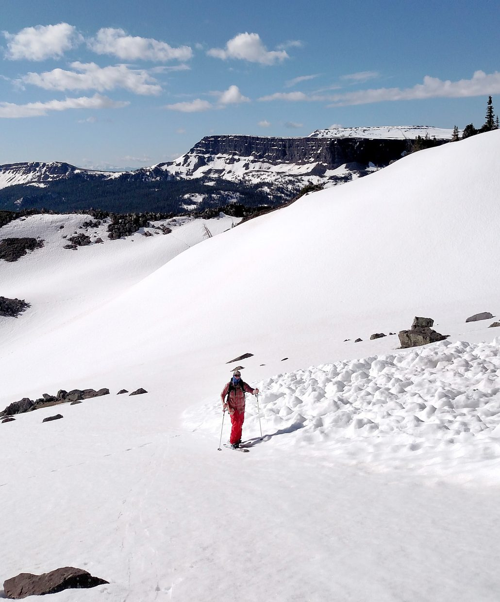 South Routt resident Brian Dudley climbs along the margin of an avalanche debris field June 7 just southeast of the Devil's Causeway cirque in the Flat Tops Wilderness Area. He and companion Matt Wood turns in the spring corn on their splitboards. Above average May precipitation had boosted snowpack in the Yampa River Basin to 98 percent of median on June 1.