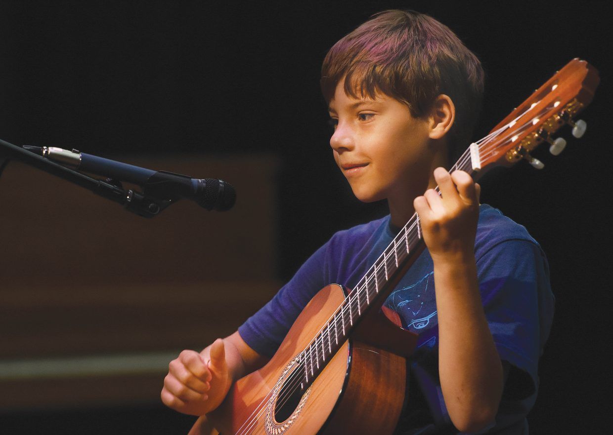 Soda Creek Elementary School third-grader Beck Vanderbosch plays his guitar during the school's end-of-year talent show Wednesday morning. It was the final day of class for the school this year.
