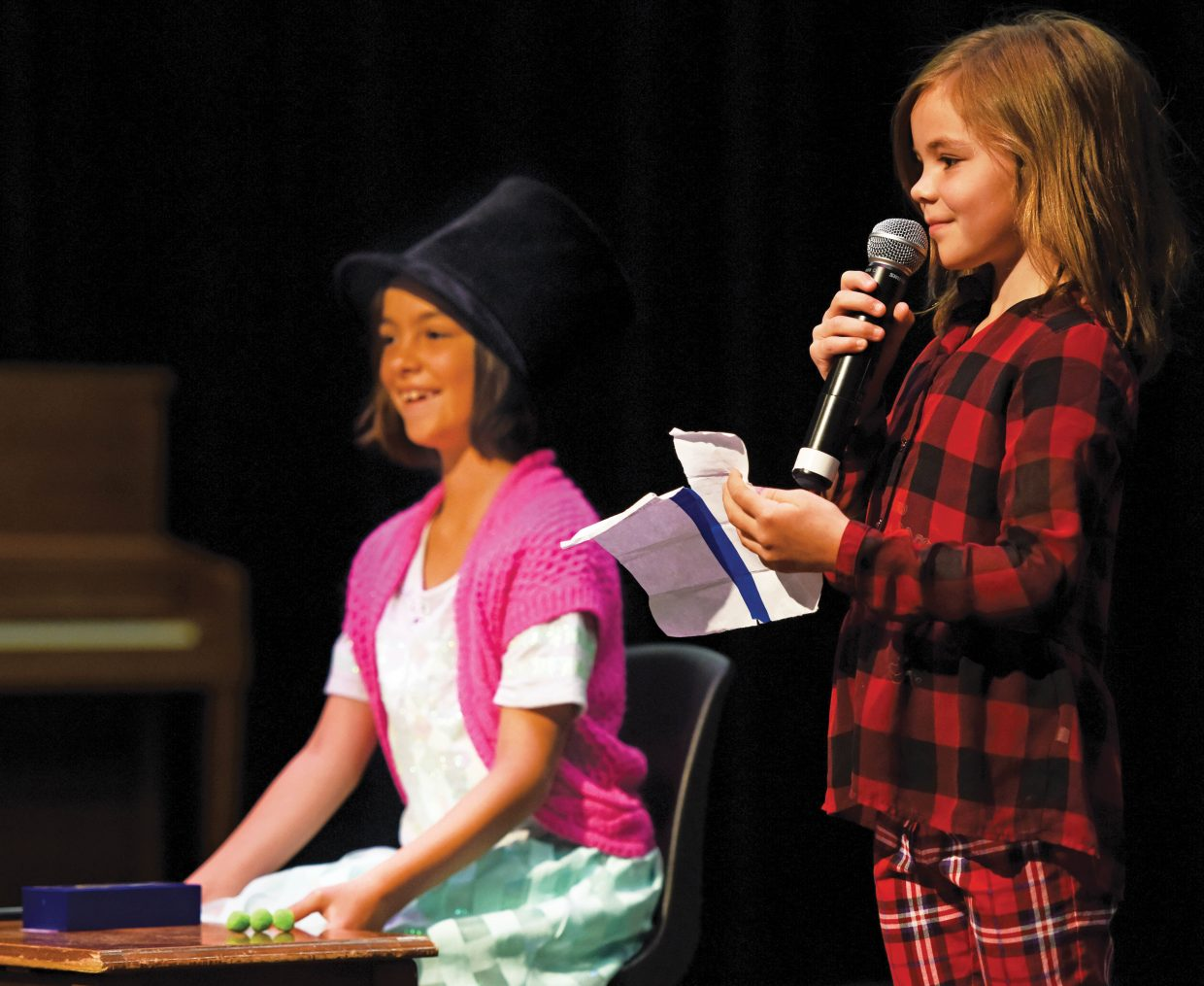 Maile Buschmann, a first-grader at Soda Creek Elementary School, performs with her older sister Kealia, a third-grader, during the school's end-of-year talent show Wednesday morning. It was the final day of class for the school this year.
