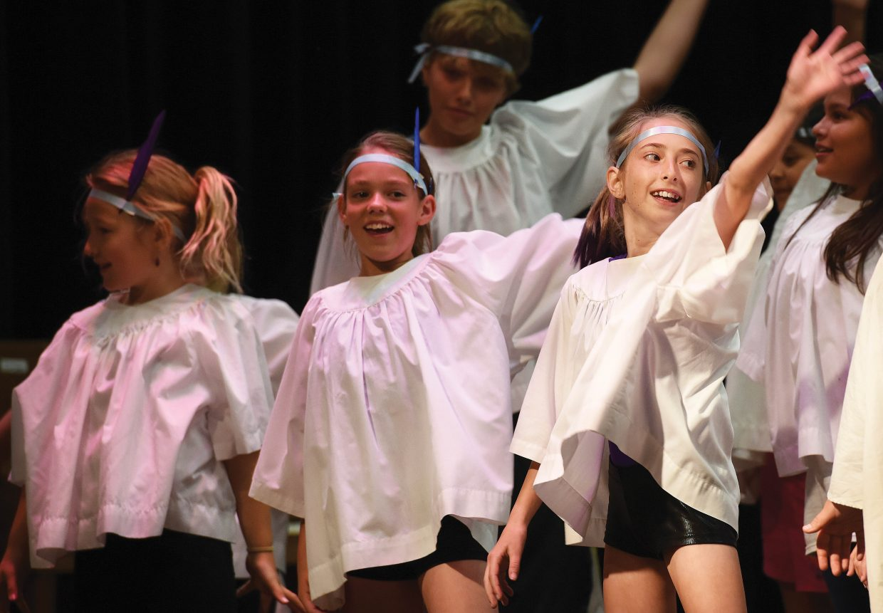 Soda Creek Elementary School students Elise Colby, right, Eliza Bodden, middle left, and Parker Lindquist, back row middle, dance during the school's end-of-year talent show Wednesday morning. It was the final day of class for the school this year.
