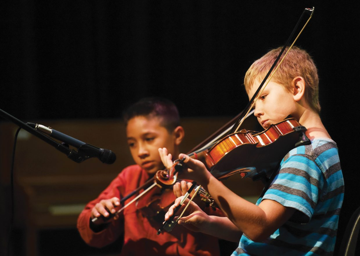 Soda Creek Elementary School fourth-graders Hayden Brewer, front, and Bryan Rios perform during the school's end-of-year talent show Wednesday morning. It was the final day of class for the school this year.
