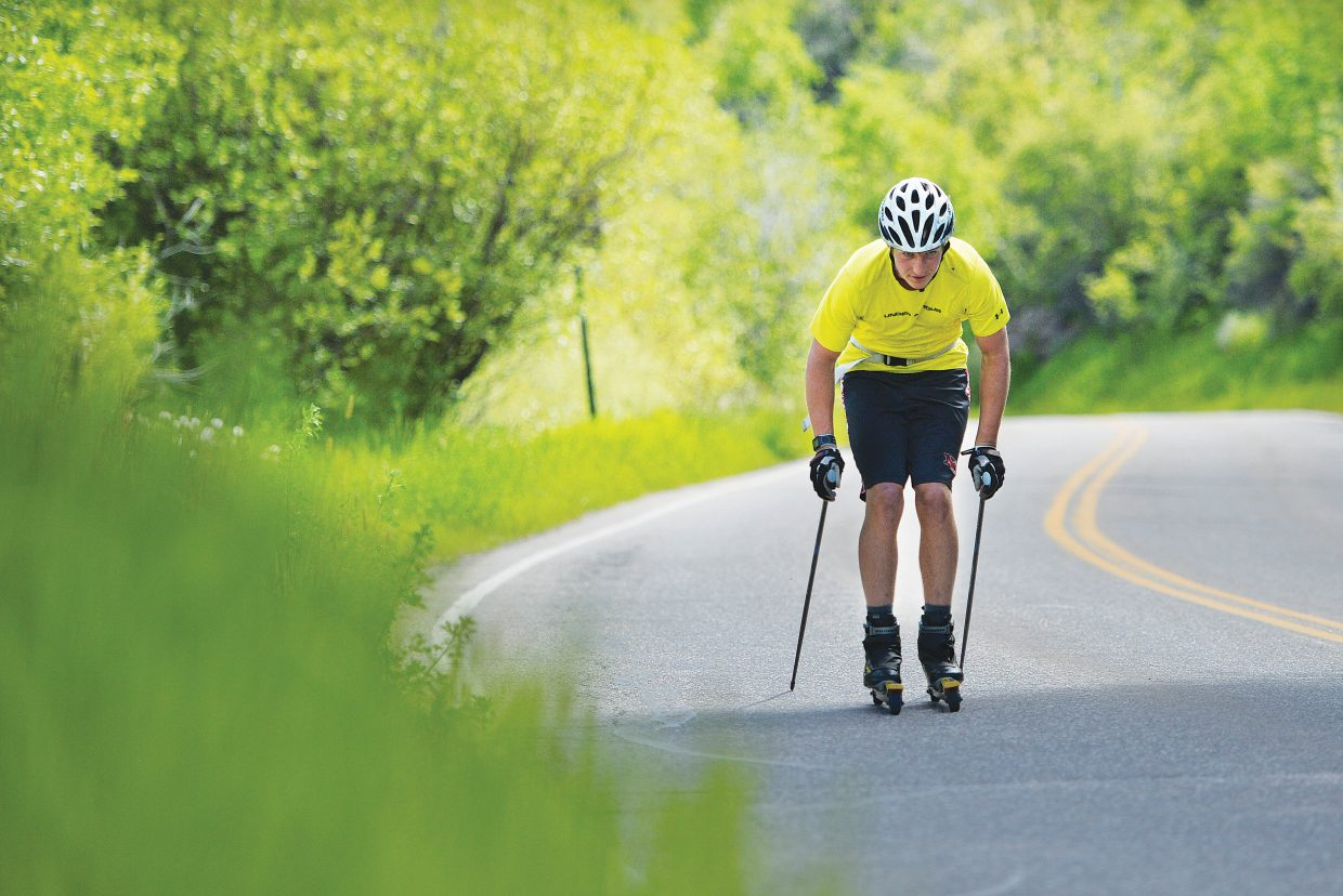 Nordic skier Noel Keeffe makes his way along River Road Tuesday afternoon during an off-season training session. Roller skis help nordic athletes continue to progress through the summer by offering a workout similar to what they might get on snow.