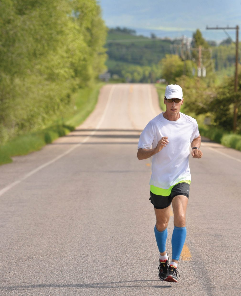 Nate Anderson takes a run along Routt County Road 36 Monday afternoon.