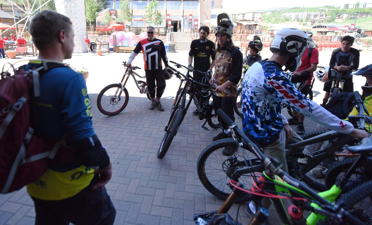 Steamboat Bike Park manager Trevyn Newpher runs over the open trails with riders before the park opened Thursday for Routt County Riders Sponsorship Day.