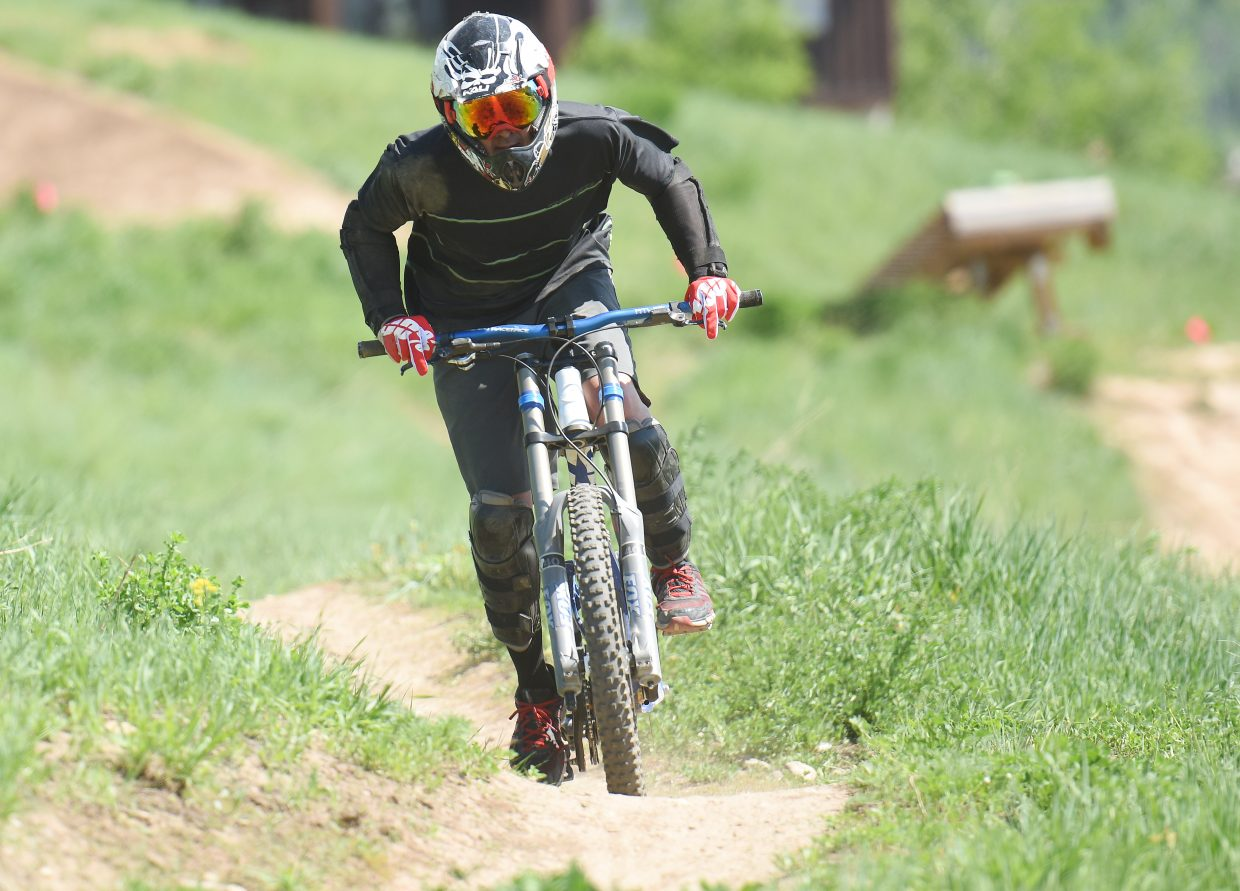 A rider rolls toward the bottom of the hill at Steamboat Bike Park on Thursday.