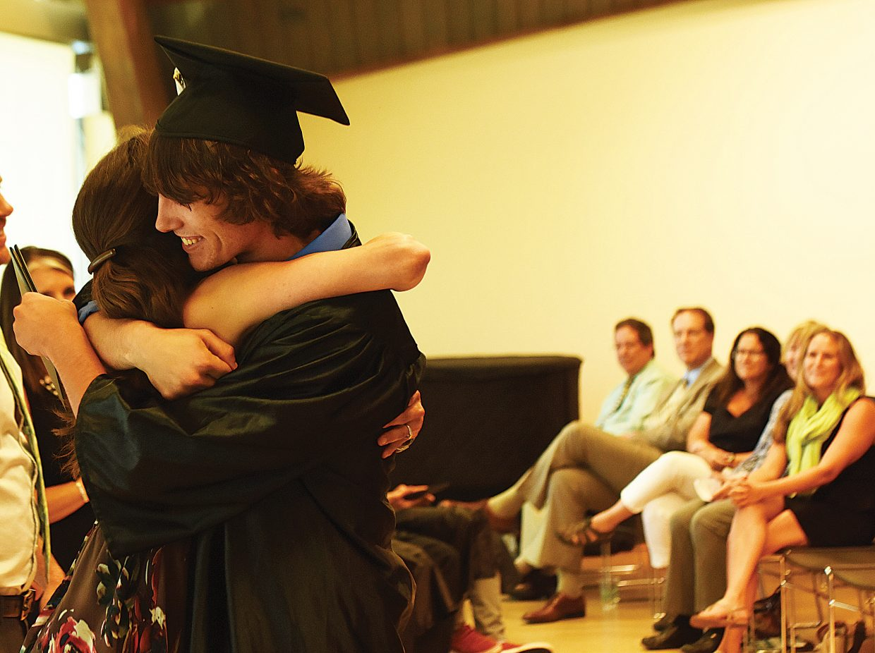 Yampa Valley High School graduate Jack Hunter gets a hug during the school's 2016 graduation ceremony at the Bud Werner Memorial Library Thursday afternoon.