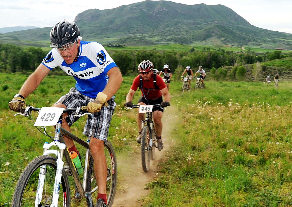 JP Pougiales leads a pack of riders with during a Town Challenge Mountain Bike Race Series race at Marabou Ranch in 2011. The series skipped the venue last year, but returns today for the first race of the 2014 season.