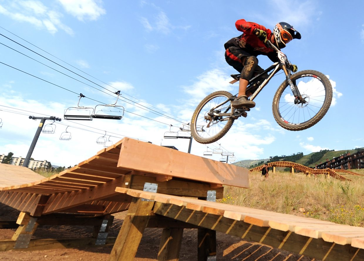 Dylan Gressett flies off a jump last year while riding the downhill mountain bike park at Steamboat Ski Area. The park opens Thursday for the summer with a Scholarship Day event. Passes are $15 and will benefit Routt County Riders.