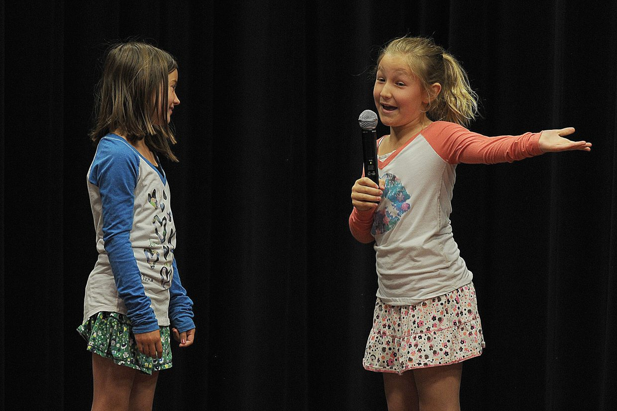 Kylie Kuhl, left, and Eliza Bodden perform a skit as part of the Soda Creek Elementary School Talent Show on Wednesday.
