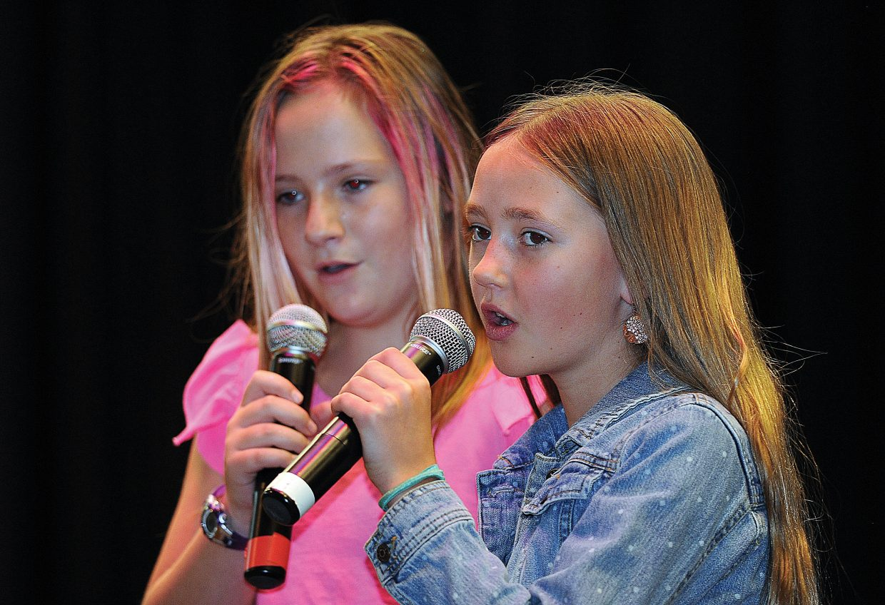 """Ryli Adrian, front, and Jada Brown perform """"Pocket Full of Sunshine"""" as part of the Soda Creek Elementary School Talent Show on Wednesday."""