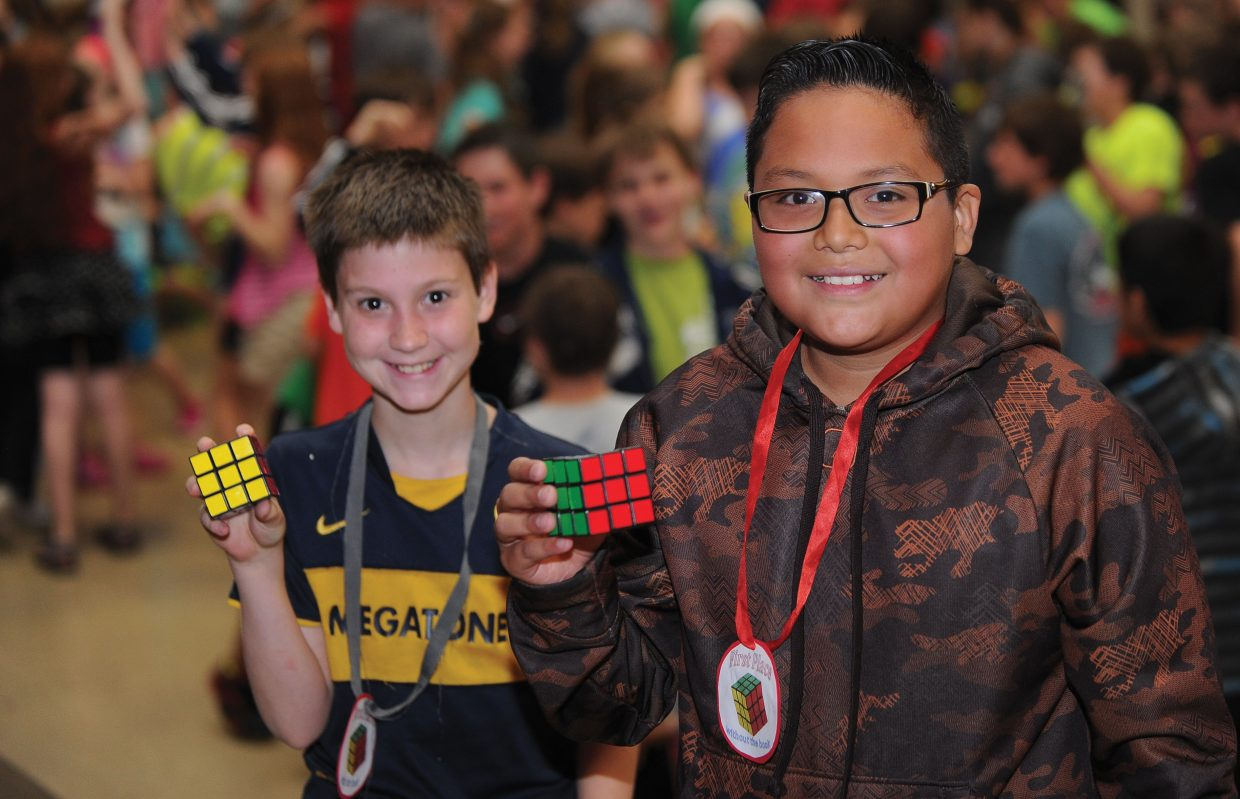 Micah Clark, right, and Daniel Hernandez topped the field in Steamboat Springs Middle School's first Rubik's Cube contest. Hernandez posted the fastest time using a solution book, and Micah finished the puzzle without the book. The context was just part of the end-of-year activities at area schools.