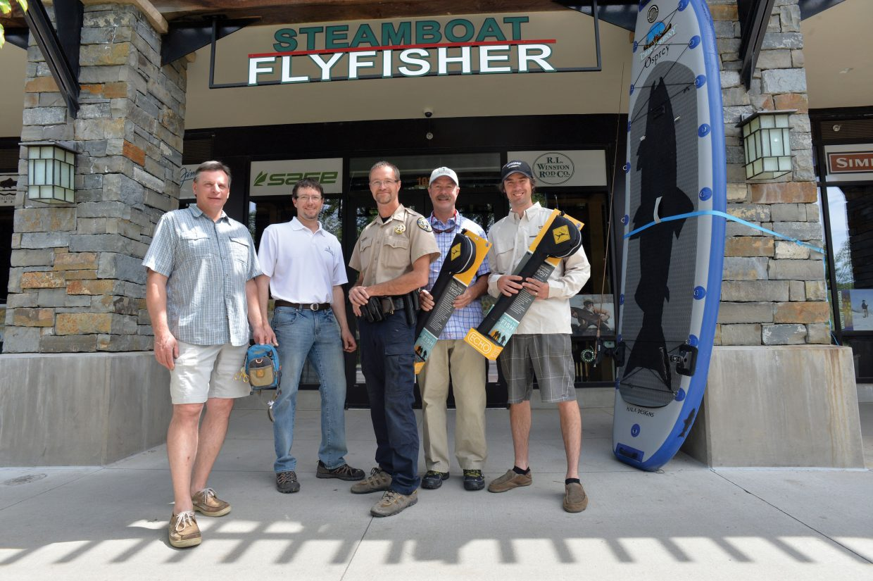 Yampa Valley Fly Fishers, with the help of Johnny Spillane at Steamboat Flyfisher, donated 20 fly-fishing poles to Colorado Parks and Wildlife on Wednesday morning. Yampa Valley Fly Fishers raised the money for the poles — while Spillane offered at a great deal to make the event possible — and gave them to Stagecoach State Park Manager Craig Preston, who said they will be used for educational programs. On hand for Wednesday's event were, from left, Yampa Valley Fly Fishers Vice President Bruce Carta; Yampa Valley Fly Fishers President Scott Warner; Preston; Yampa Valley Fly Fishers head of youth outreach Greg Pohlman; and Spillane.