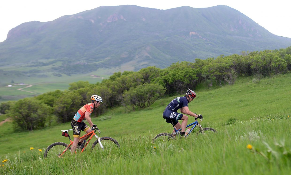 A pair of riders work up a rise at Marabou Ranch on Wednesday during the season's first Town Challenge Mountain Bike Series race. The event drew 193 rides to the green, rolling hills of the rural Routt County ranch.