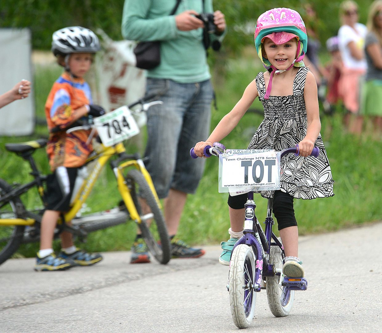 Reesa Pond, 4, rides in Wednesday's Town Challenge race.