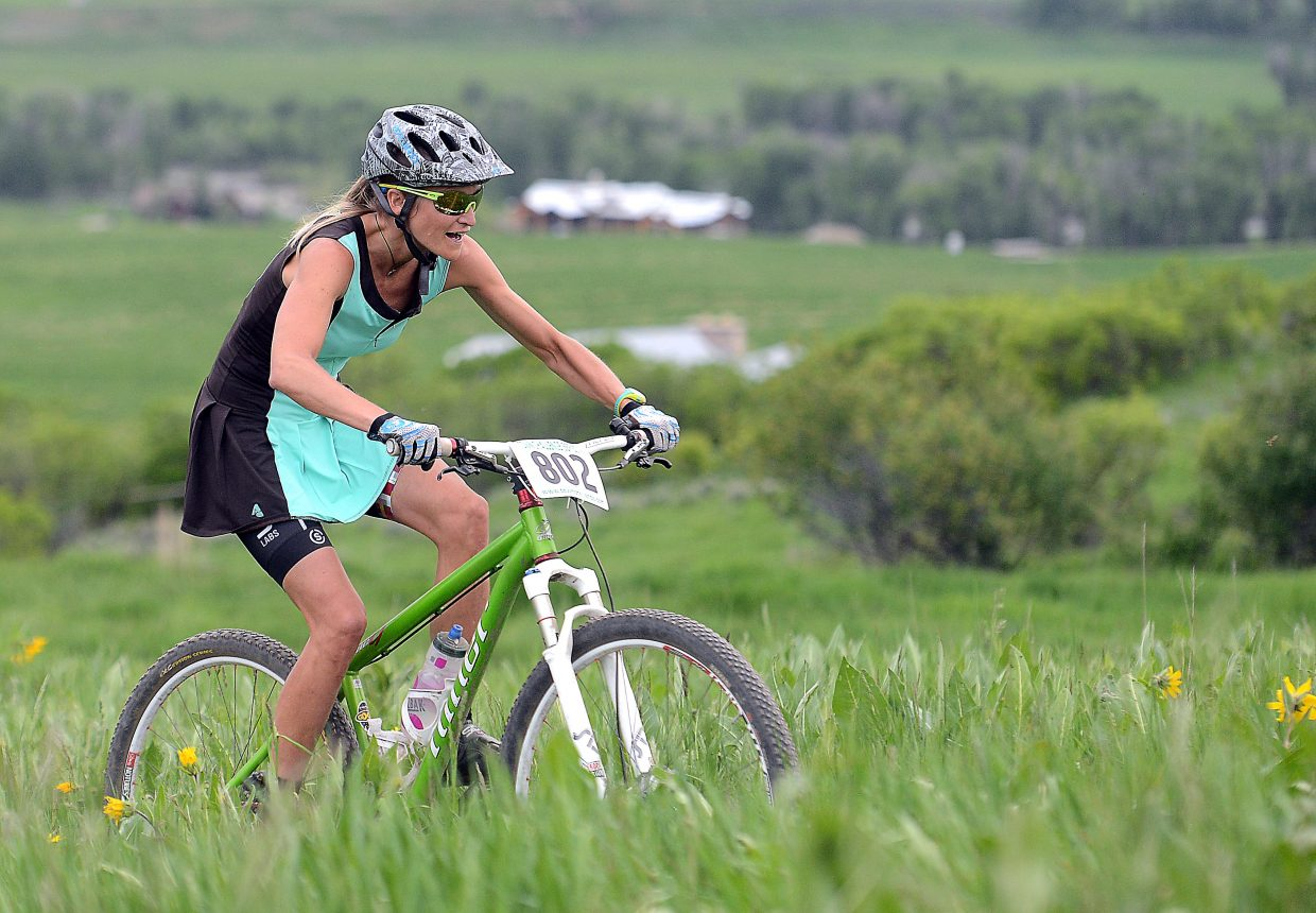 Marla Bailey rides in Wednesday's Town Challenge mountain bike race.
