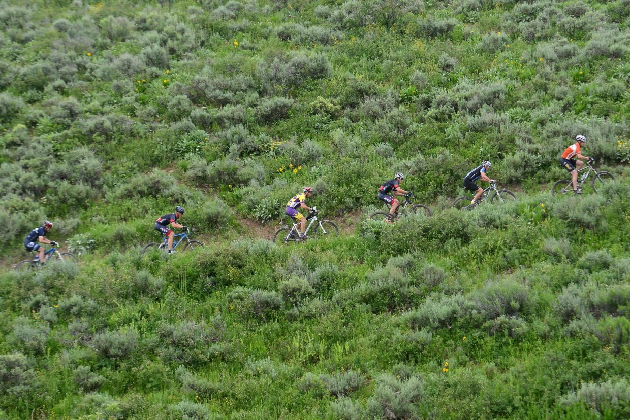 Riders make their way along a hill during Wednesday's Town Challenge Mountain Bike Series event at Marabou Ranch.