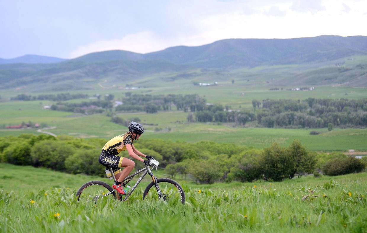 Hannah Williams rides across Marabou Ranch on Wednesday during a Town Challenge mountain bike race.
