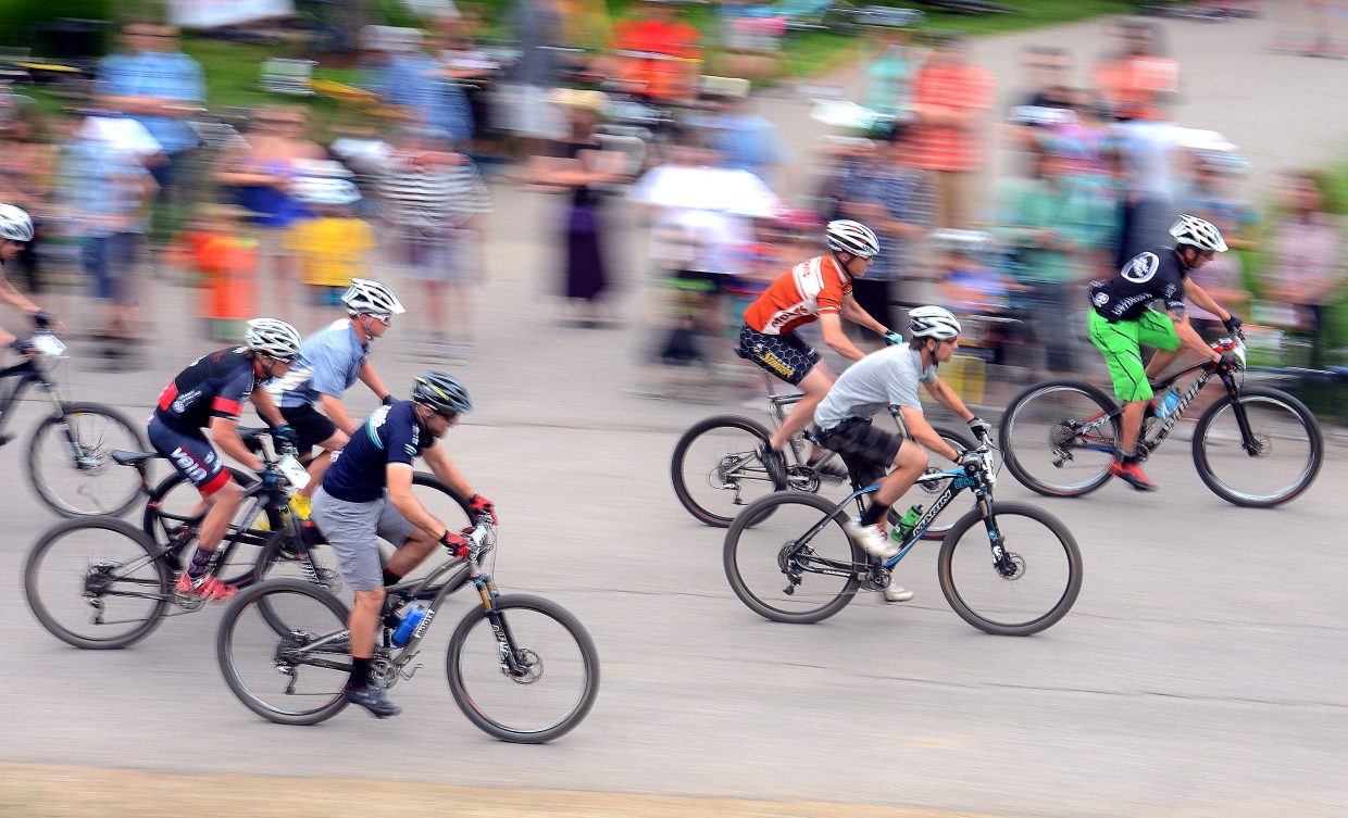 Riders in the men's expert division start Wednesday's Town Challenge mountain bike race.
