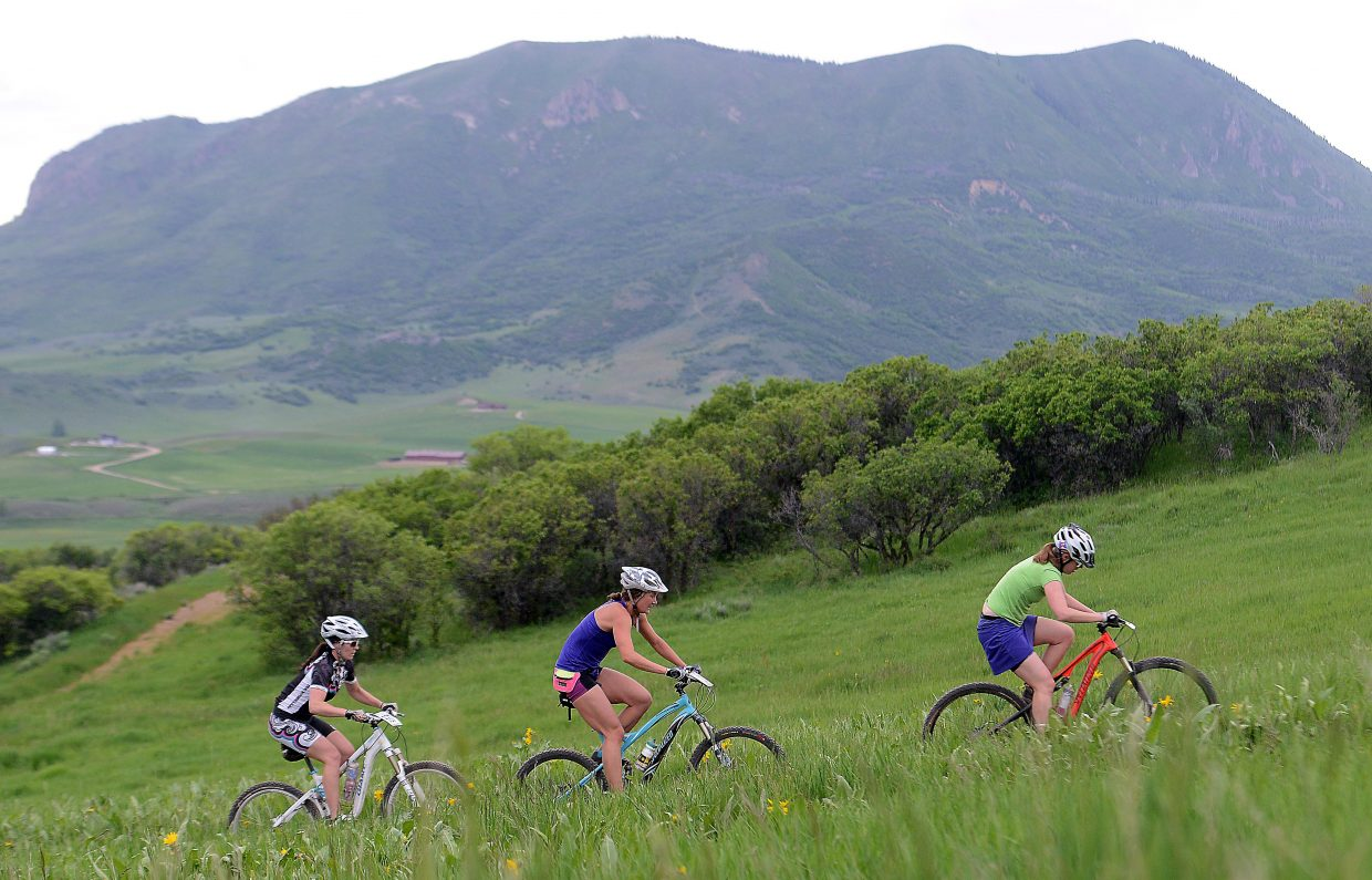 Emily Lawrence, right, Hannah Gary and Eliza Outtrim ride during Wednesday's Town Challenge mountain bike race at Marabou.