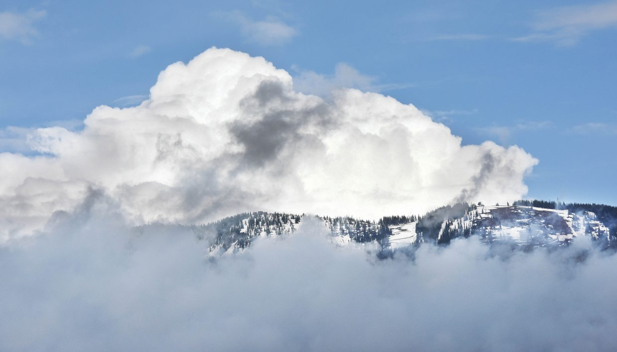 Early evening storm clouds parted leaving this majestic view of the slopes of the Steamboat Ski Area.