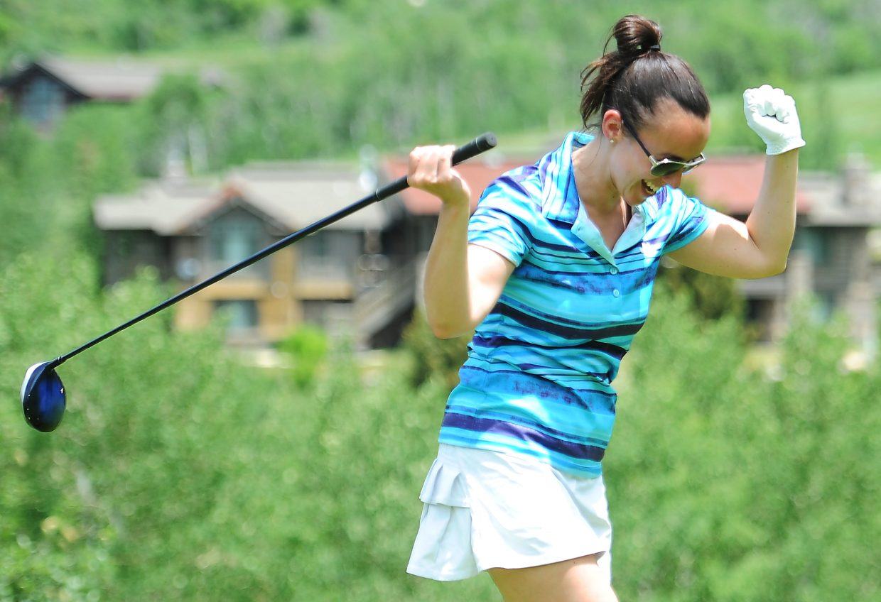 Jackie Brown shows her approval of a shot she launched on the fifth hole Saturday during the Ski Town Classic golf tournament at Catamount Ranch & Club golf course.
