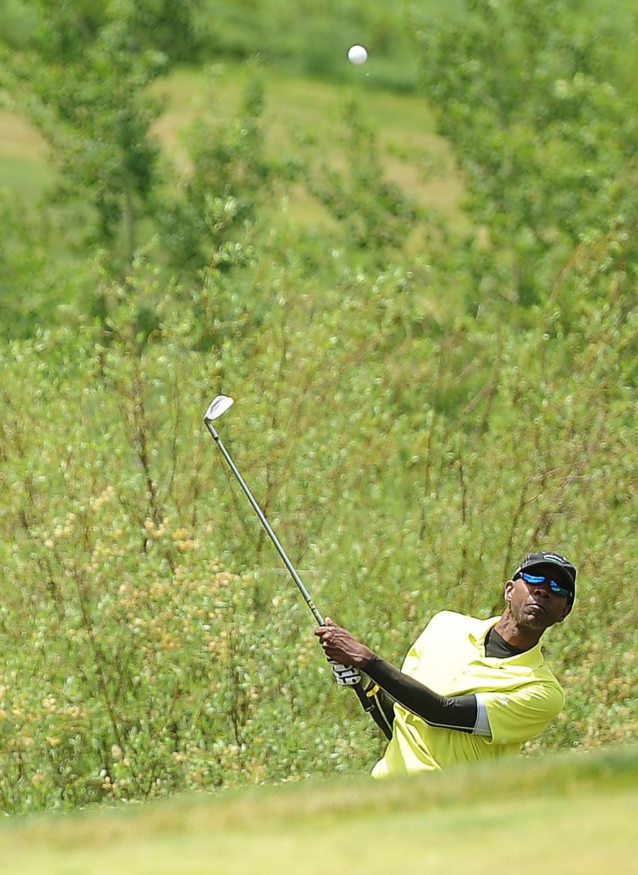 Tony Counts watches after chipping his ball high toward the green Saturday during the Ski Town Classic golf tournament at Catamount Ranch & Club golf course.