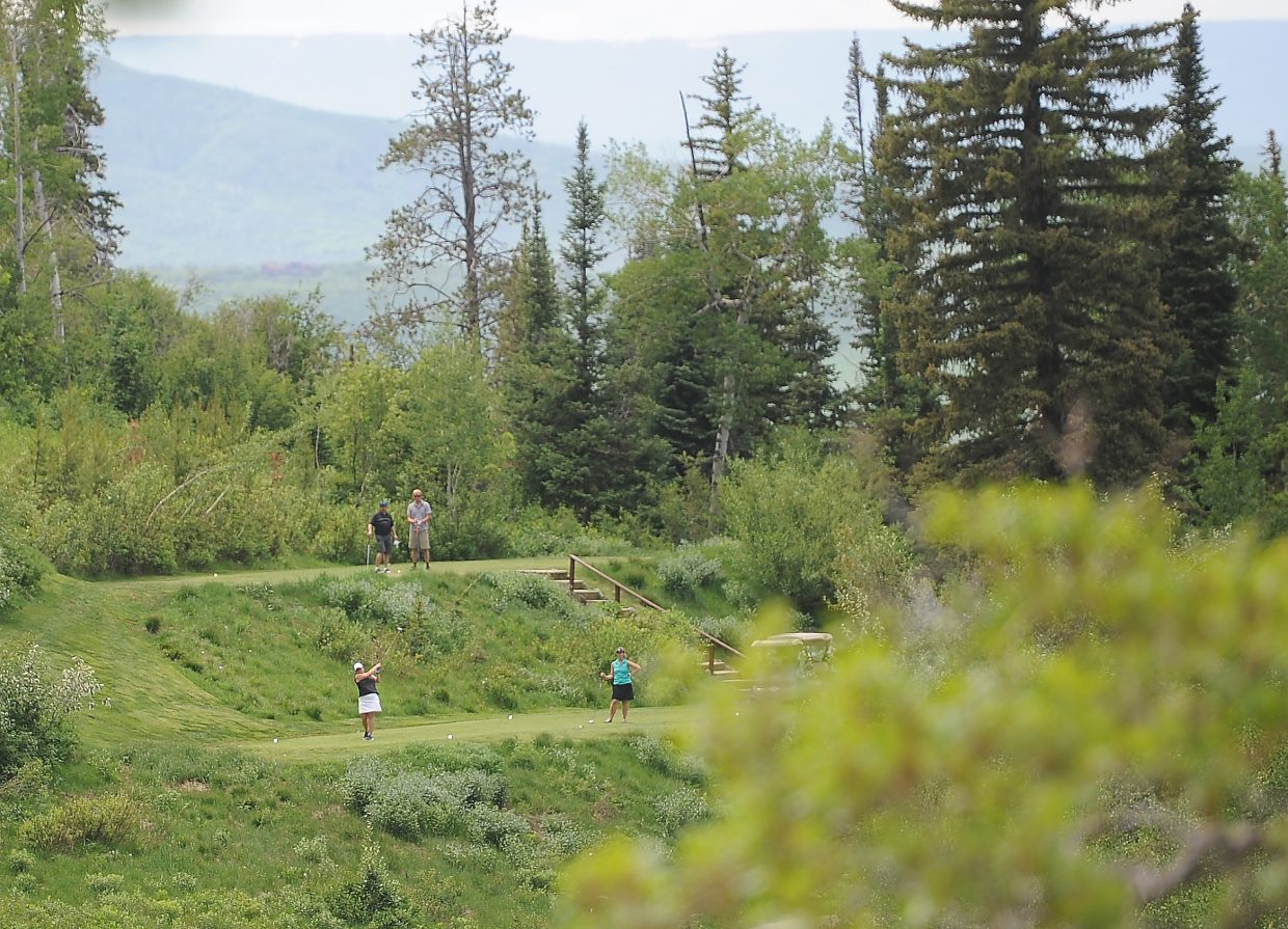 Players tee off Saturday during the Ski Town Classic golf tournament at Catamount Ranch & Club golf course.