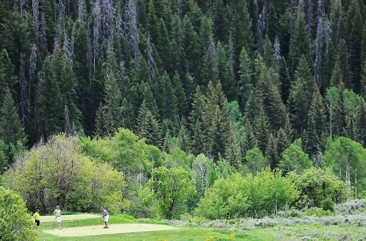 Jeff Messinger tees off Saturday during the Ski Town Classic golf tournament at Catamount Ranch & Club golf course.