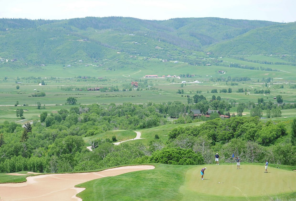Golfers try to hole out Saturday during the Ski Town Classic golf tournament at Catamount Ranch & Club golf course in Steamboat Springs.