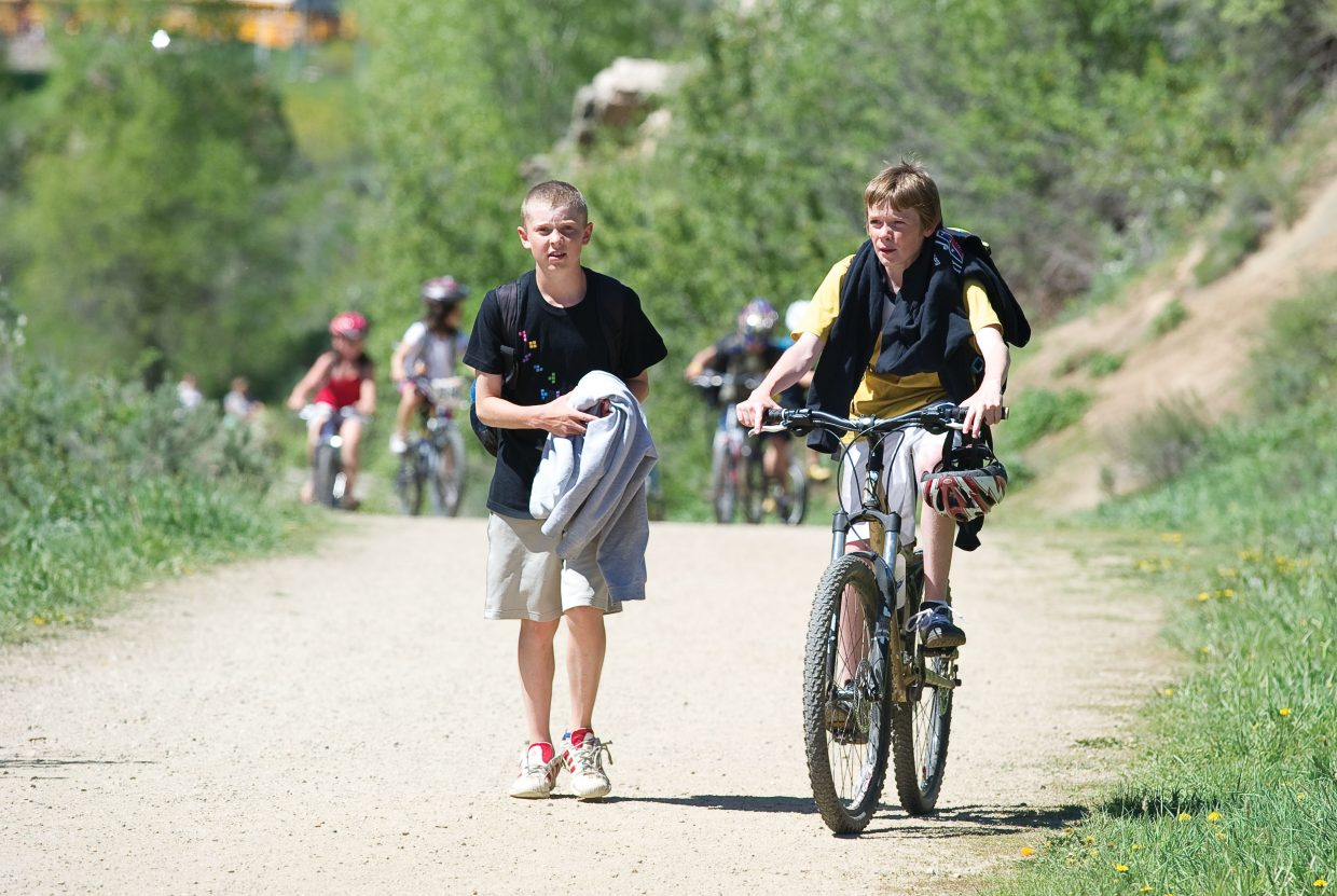 Charlie Beurskens, left, and Finn O'Connell commute home from Steamboat Springs Middle School in 2011 using the trail that passes through Butcherknife Canyon. The Safe Routes to School program funds grants that support projects to help school children walking or biking find safe ways to get to school, and state Rep. Diane Mitsch Bush, D-Steamboat Springs, is working to keep grant funding alive in Routt County.
