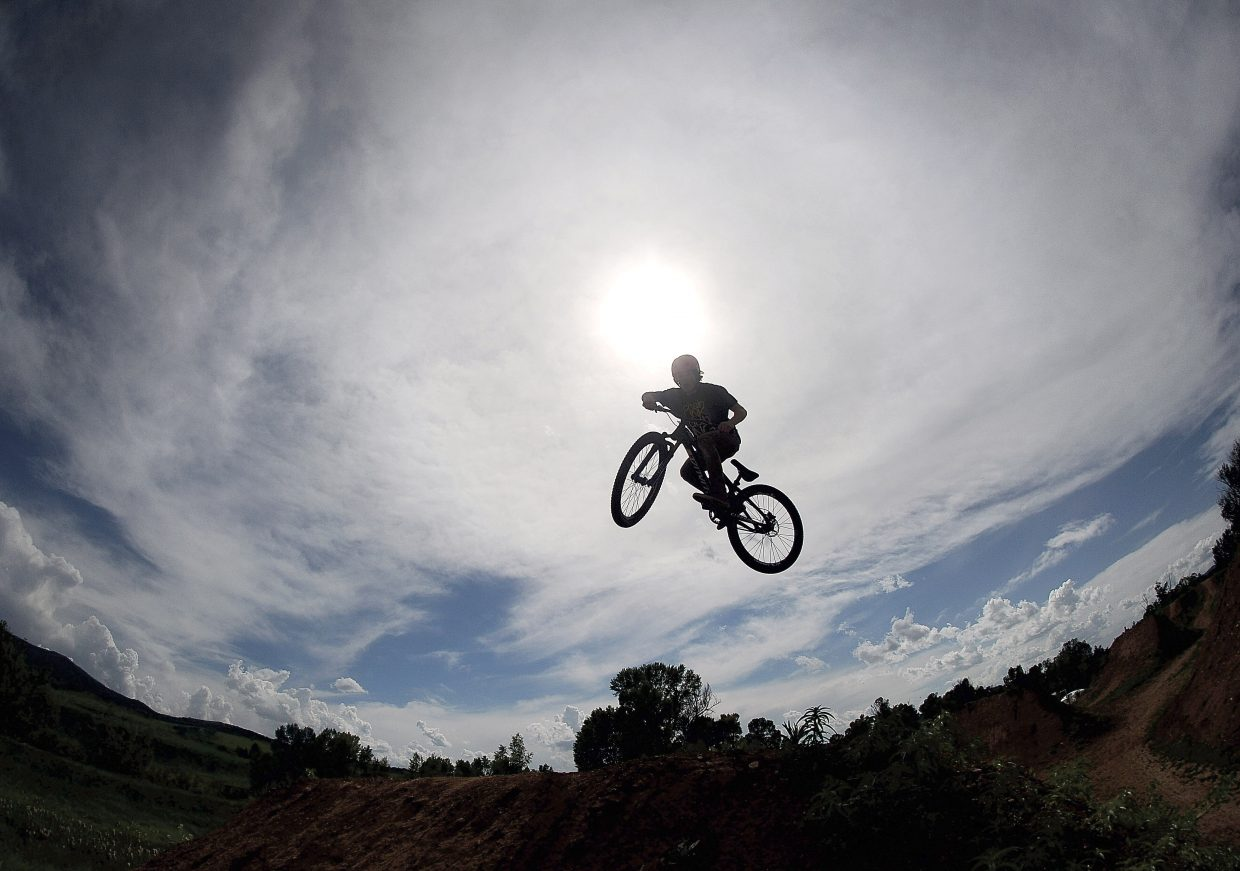 Cyclist Max Parsons launches off a jump at the Bear River Bike Park earlier this week. At 6 p.m. Friday the venue will host the first-ever Jump Jam and Photo Shoot-Out.