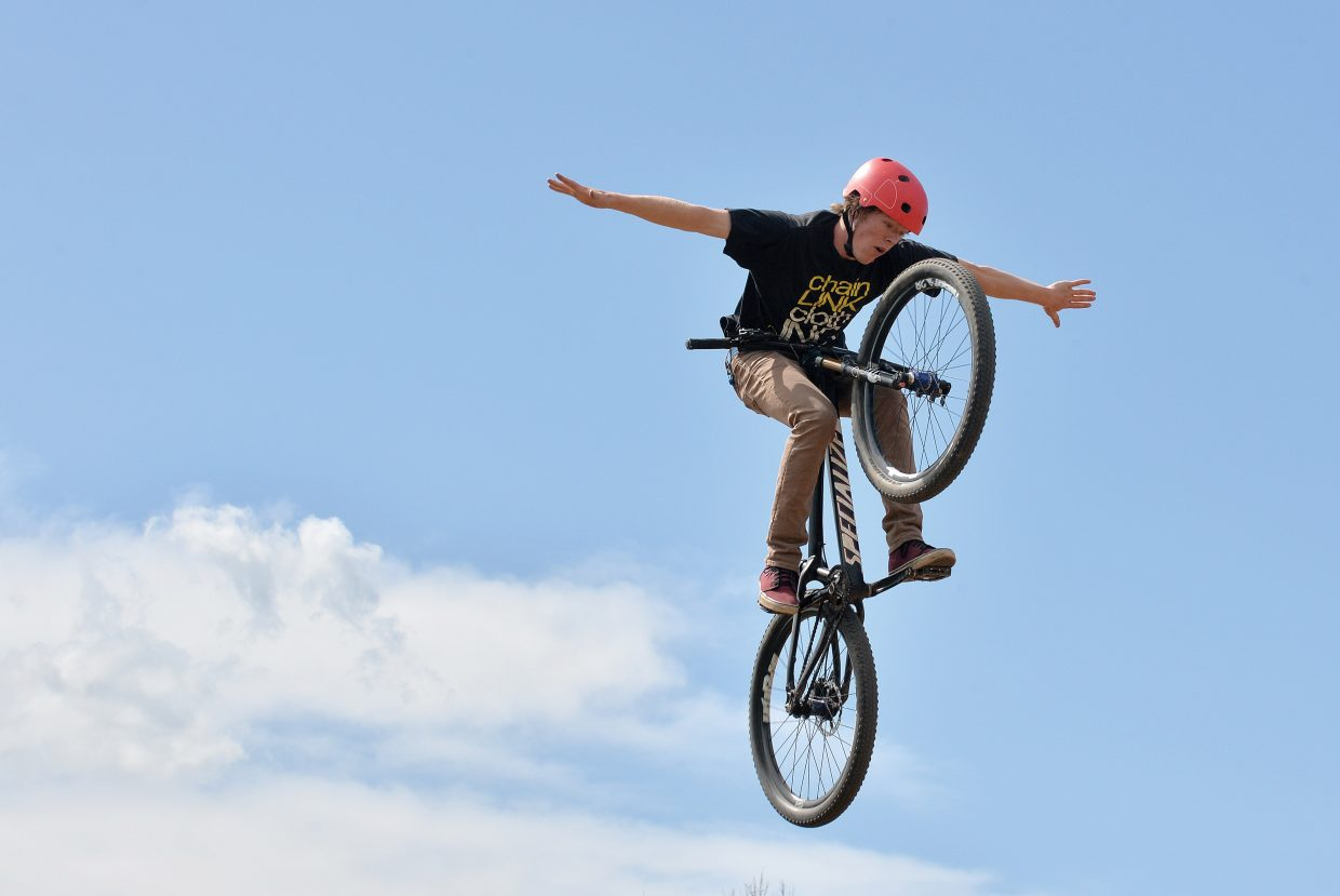 Cyclist Max Parsons launches off a jump at the Bear River Bike Park earlier this week.