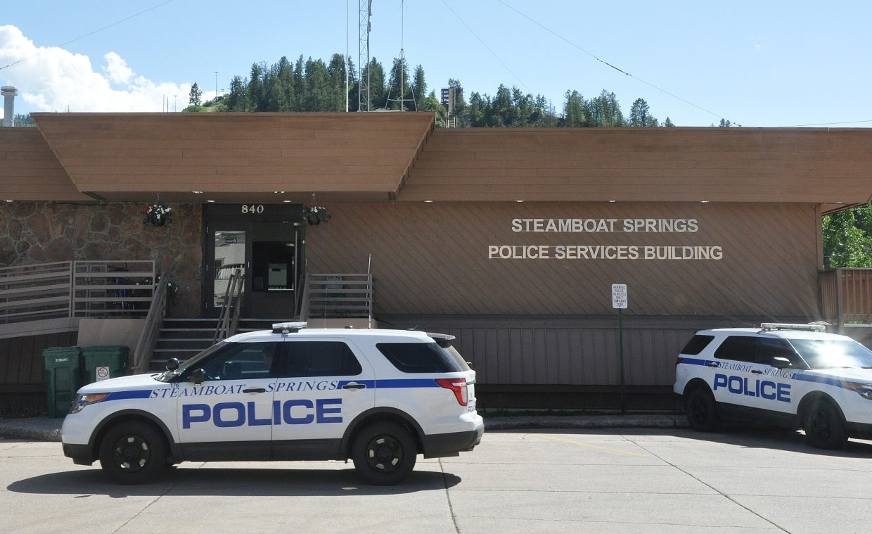 A Steamboat Springs Police vehicle leaves the current police station in June.