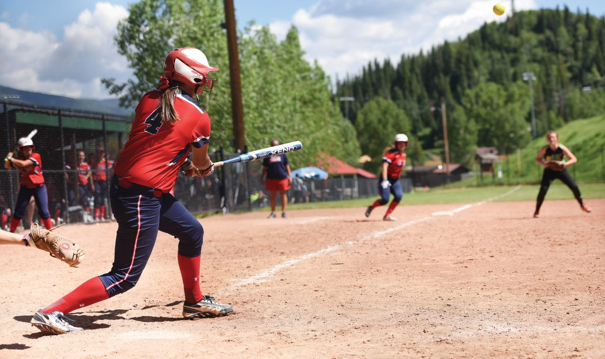 TCS batter Allie Mason smacks a ball past the infield during her team's win.
