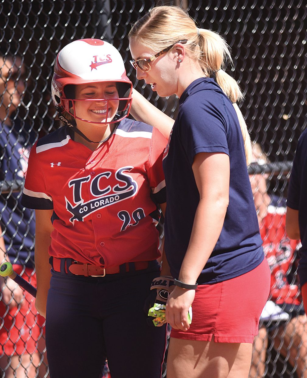 TCS player Brittany Bigge gets a few words of encouragement from her coach Friday afternoon during the Triple Crown Mountain Magic girls fast pitch softball tournament.