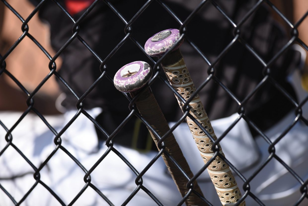 Bats line the fence of a dugout Friday afternoon as the Mountain Magic girls fast pitch softball tournament opened in Steamboat Springs.