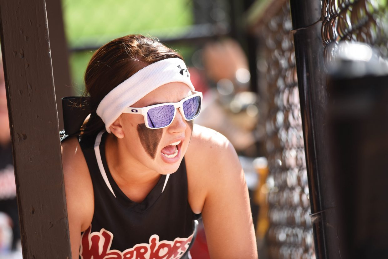 Desi Ramirez cheers for her Warriors teammates during a game Friday afternoon at Howelsen Hill during the Triple Crown Mountain Magic girls fast pitch softball tournament.