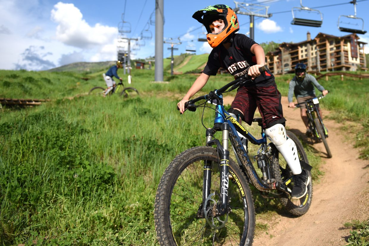 Jensen Weisinger, 12, leads the way for Chris Zolman and Jaime Weisinger on Friday evening at Steamboat Ski Area on opening day for Steamboat Bike Park. Rain canceled a planned opening Thursday, but Friday's sun dried the trails and riders rolled.