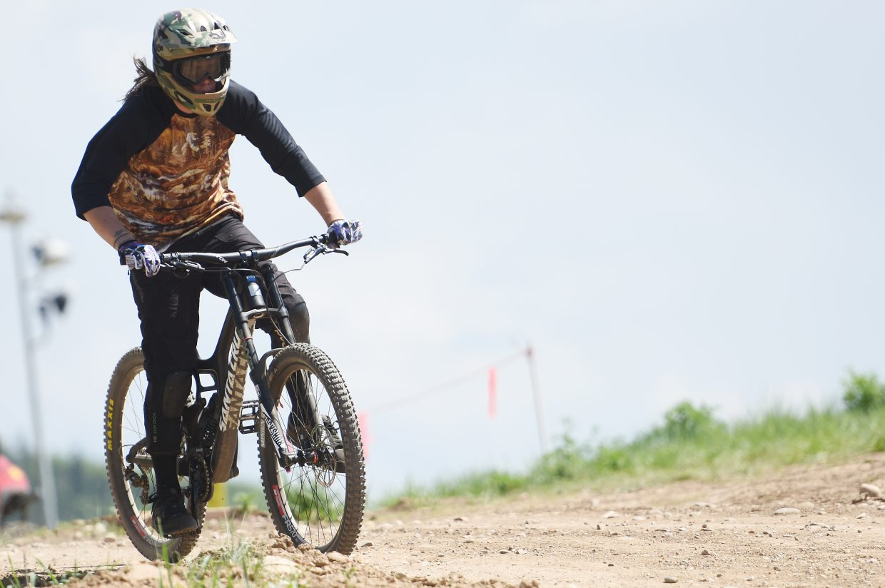 Nate Medina rides down a trail in the Steamboat Bike Park, completing the first run of the season after the park opened for the summer on Thursday. Steamboat Springs Bike Town USA's Bike Week kicks off Monday and runs through Sunday with events scheduled daily around town.