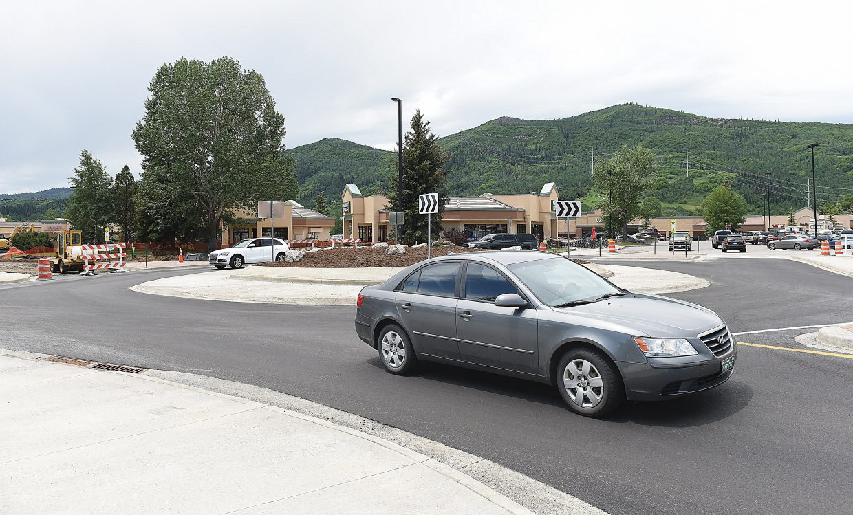 After weeks of construction, the new roundabout at Central Park Plaza was opened to traffic earlier this month, marking a shift in the way traffic is moving in front of the busy shopping center.