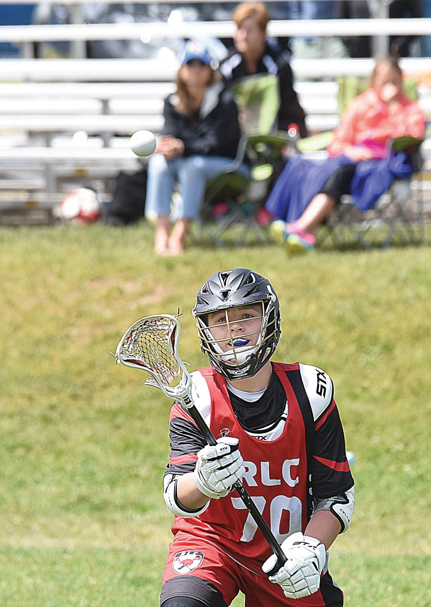 Conner Waite, a player for the Rams Lacrosse Club, looks for a pass in front of the goal during a loss to Team Six Bravo on Monday. The two teams were competing on the first day of the Steamboat Showdown Lacrosse Tournament, which opened Monday with teams playing in the U11, U13, U15 and high school divisions. The tournament will continue through Wednesday at Ski Town and Whistler fields.
